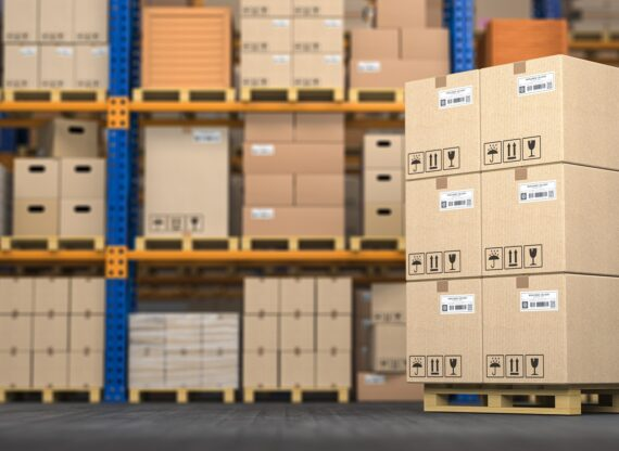 Warehouse or storage with cardboard boxes on a pallet. Logistics